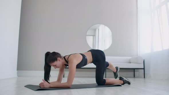 Thumbnail for Home Exercises for a Beautiful Body. European Brunette Woman Doing Exercises