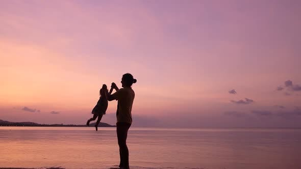 Thumbnail for Father and Children Having Fun on the Tropical Beach at the Sunset Time. Happy Family Concept.