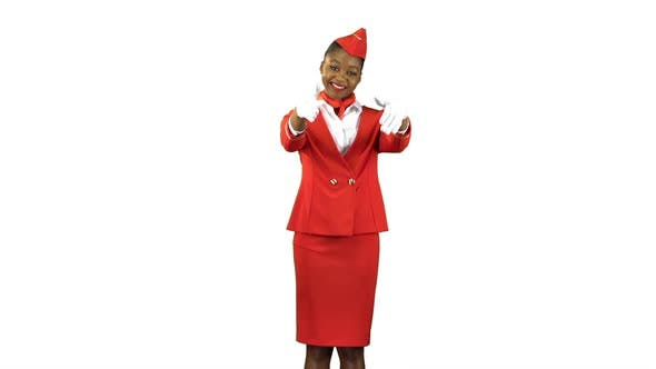 Thumbnail for Stewardess in White Gloves Gestures Showing Where the Emergency Exit Is. Alpha Channel