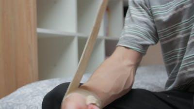 Puts On Bandage On Hand