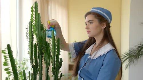 Caucasian Housemaid at Work.