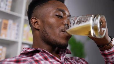 Happy african man drink beer with happiness on relax time