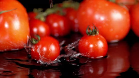 Thumbnail for Cherry Tomatoes Falling Into the Water.