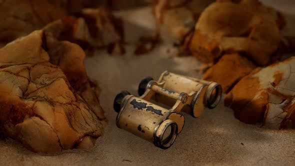 Thumbnail for Old German Military Binoculars on the Sand Beach