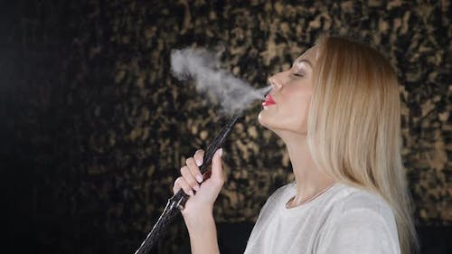 Smoke Being Breathed Out in Slow Motion By Attractive Woman in White Tshirt