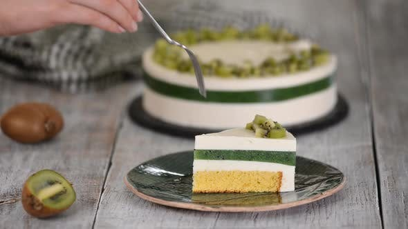 Thumbnail for Eating piece of homemade mousse cake with kiwi