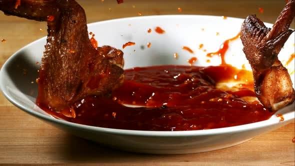 BBQ Chicken splashing in ultra slow motion 1500fps into BBQ sauce - BBQ PHANTOM