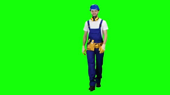 Thumbnail for Builder Goes To the Object with a Helmet and Tools. Green Screen