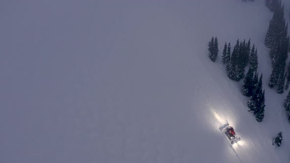 Thumbnail for High Above Ski Slope View Of Snow Groomer Driving Over Snowfield To Improve Trail Conditions