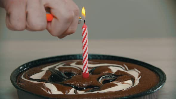 Lighting a Candle on a Cake with a Lighter