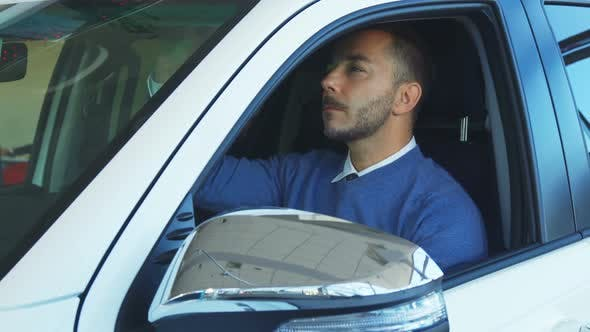 Thumbnail for Smiling Man Examines Car Interior