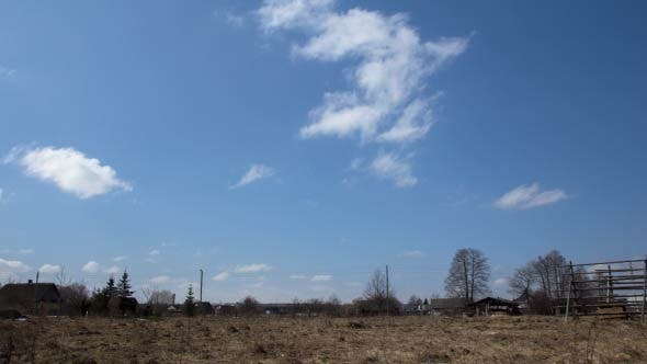 Thumbnail for Clouds over Village, Forest - Time Lapse (2 Shots)