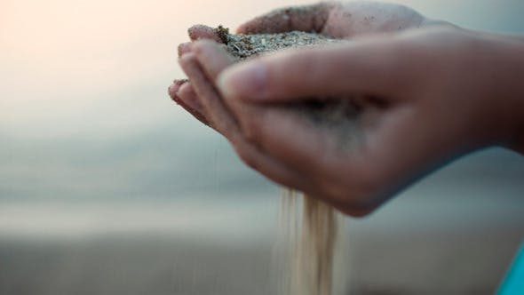 Cover Image for Sea Sand Running Through a Womans Hands