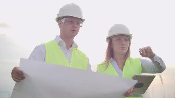 Coworking Engineers with Tablets on Solar Plant