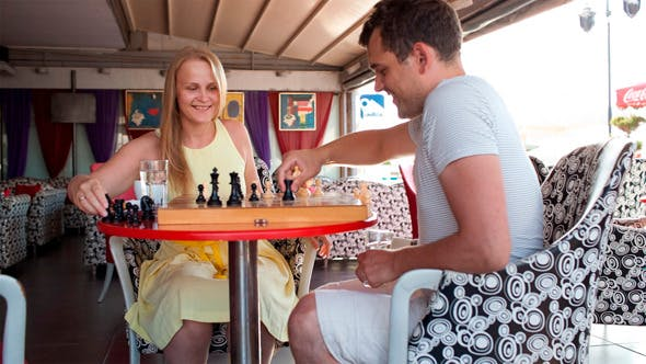 Thumbnail for Smiling Couple Playing a Game Of Chess