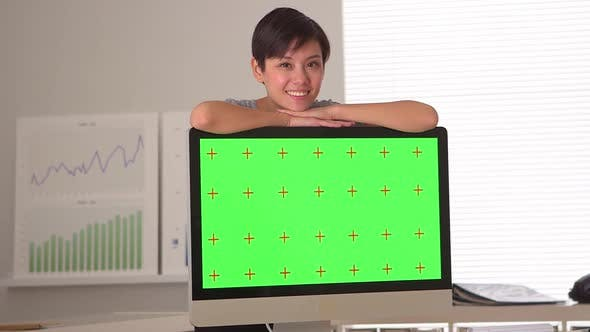 Thumbnail for Chinese businesswoman standing by green screen computer