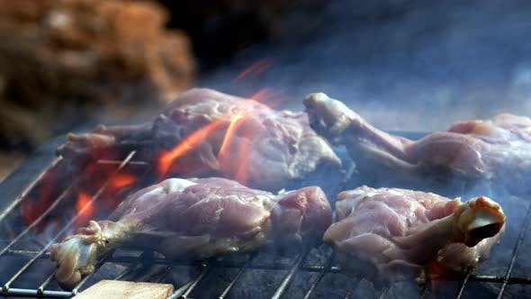 Chicken On Barbecue And Fire