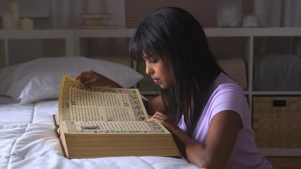 Thumbnail for African American girl reading bible