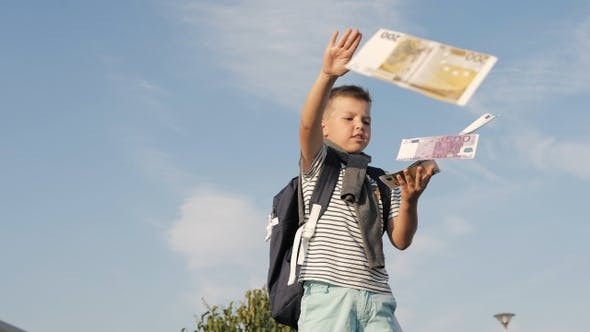 Thumbnail for Little boy making euros banknotes fly.