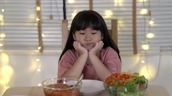 Little girl dinner alone