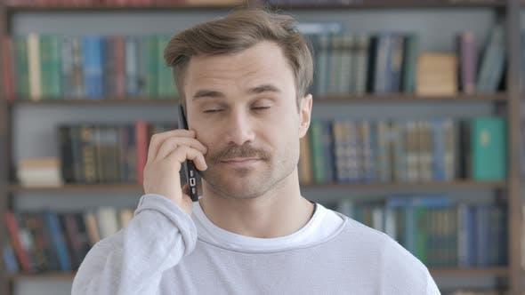 Portrait of Adult Man Talking on Phone