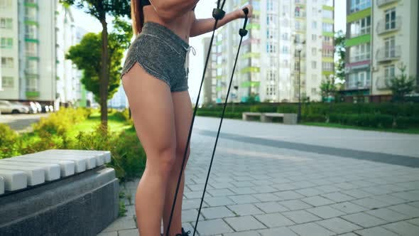 Thumbnail for Sportswoman Training Biceps Using Elastic Rope Band Outdoors.