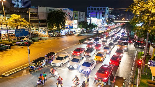 Cover Image for Busy Traffic Jam Intersection At Night TImelapse