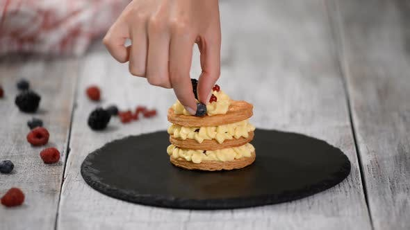 Thumbnail for Pastry chef making French Mille Feuille with custard and berries.