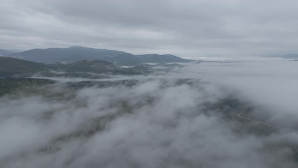 Ukraine, Carpathians: Fog in the Mountains. Aerial. Gray, Flat