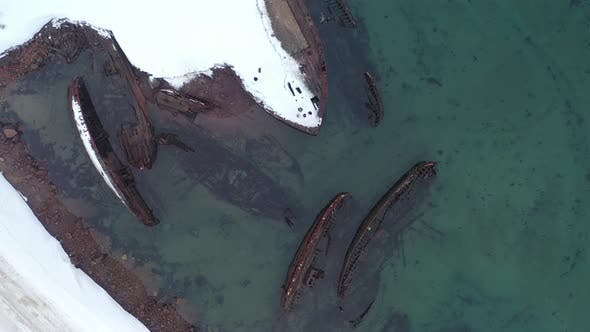 Thumbnail for Top view of many old wrecked ships
