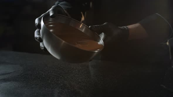 Thumbnail for Chocolatier Pours Melted Chocolate From the Bowl To the Cold Table for Tempering, Making of Sweets
