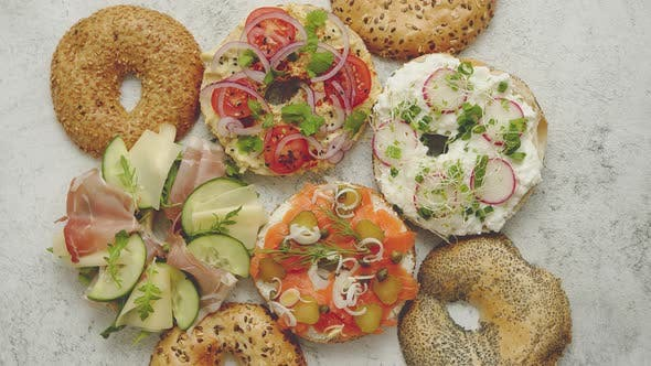 Thumbnail for Homemade Bagel Sandwiches with Different Toppings, Salmon, Cottage Cheese, Hummus, Ham, Radish