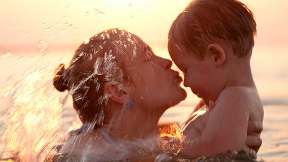 Thumbnail for Mother Kissing Her Young Child