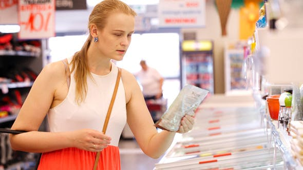 Thumbnail for Young Woman Buying Products at the Supermarket