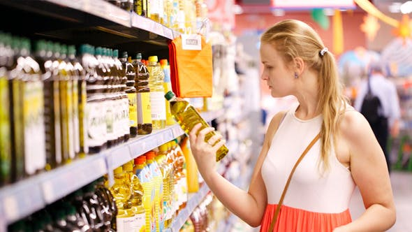 Thumbnail for Young Woman Buying Olive Oil