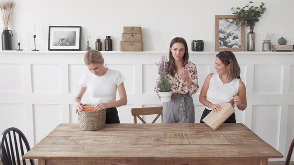 Thumbnail for Three women are putting things away in the new apartment
