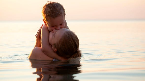 Thumbnail for Loving Mother Hugging With Her Son in the Sea
