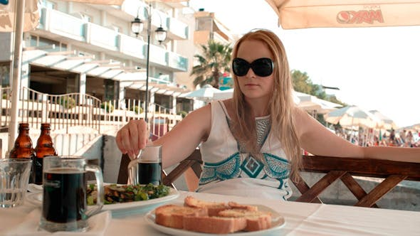 Thumbnail for Young Woman Having a Meal in an Outdoor Restaurant