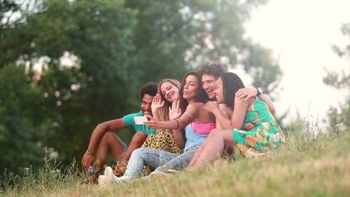 Group of friends having a great time taking selfies