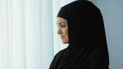 Happy Housewife in Hijab Smiling, Islamic Culture, Female Wellbeing, Traditions