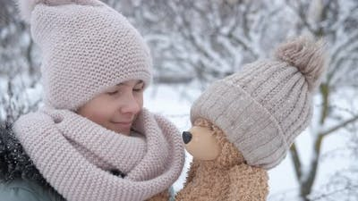 Child with Teddy in Winter Park