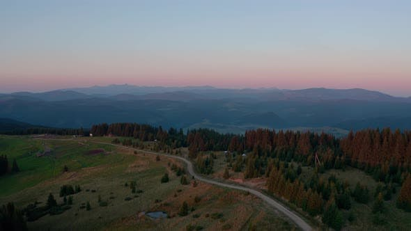 Thumbnail for Aerial Drone View a Beautiful Evening in the Mountains with the Moon. Wide Shot V3