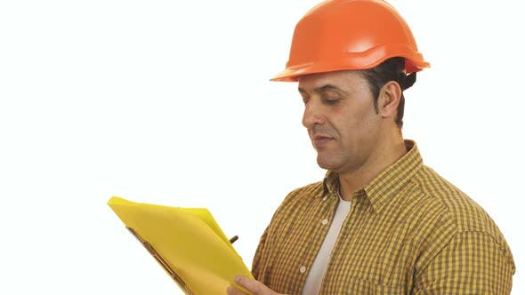 Thumbnail for Mature Foreman Builder in a Hardhat Making Notes on Clipboard