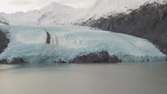 Thumbnail for Aerial wide shot of Troopers helicopter flying over iceberg drone