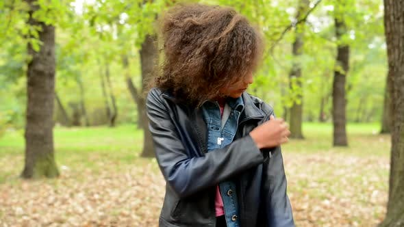 Thumbnail for Young Punctual Tidy African Girl Adjust Her Look in the Forest - She Modify Her Clothes