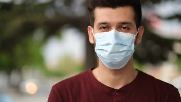 Thumbnail for Portrait of Young Male Wearing Face Mask