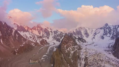 Tian Shan Mountains at Sunset. Aerial Hyper Lapse