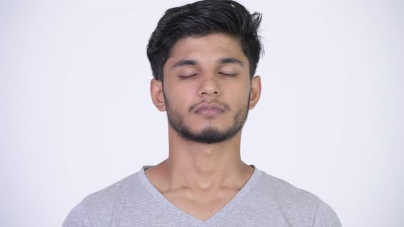 Thumbnail for Young Happy Bearded Indian Man Relaxing with Eyes Closed