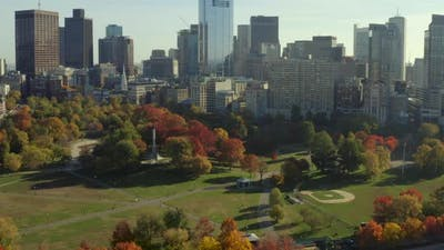 Curving shot of Boston Common approaching monument