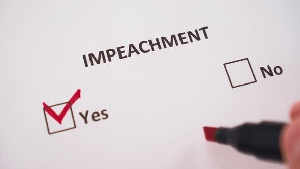The hand ticks the word YES under the word IMPEACHMENT